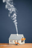 Classic house with smoke trail Royalty Free Stock Image