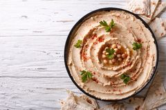 Classic hummus and pita bread. horizontal top view Royalty Free Stock Image