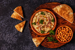 Classic hummus on the plate. Classic hummus with parsley on the plate and pita bread royalty free stock photography