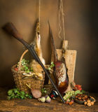 Classic hunting still life. Classic still life with dead pheasant and hare combined with autumn fruits and hunting rifle Stock Images