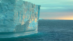 Classic iceberg in antarctica. Towering snowy mountains in antarctica with iceberg stock video footage