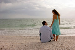 Classic image of two young lovers at the beach at Royalty Free Stock Images