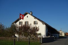 Large Swiss Farmhouse with Flag stock photography