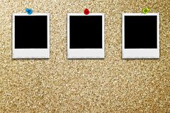 Classic instant photo frames on cork board Royalty Free Stock Photography
