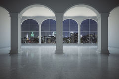 Classic interior at night. Classic concrete interior with columns and panoramic windows with illuminated night city view. 3D Rendering Royalty Free Stock Photos