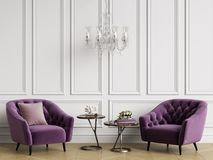 Classic interior with tufted armchairs and crystal chandelier. Stock Photo