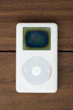 Classic Ipod. Bangkok, THAILAND - September 28, 2016: Old Classic Ipod 2th generation on wooden table Stock Photos