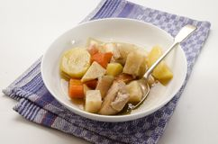 Classic irish stew with a spoon and deep plate Royalty Free Stock Photo