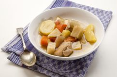 Classic irish stew with a spoon and deep plate Stock Photo