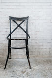 Classic iron chair with white brickbrick Stock Photo