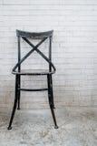 Classic iron chair with white brickbrick Stock Photo