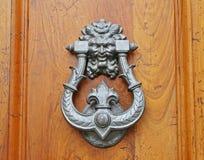 Classic iron knocker on wooden door Stock Photos