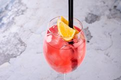 Classic Italian Aperol Spritz cocktail consisting of prosecco, aperitif and soda water with orange slice fresh fruit in Stock Image