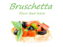 Classic Italian appetizer bruschetta with tomato, basil and blac Royalty Free Stock Photo