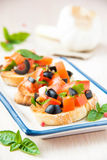 Classic Italian appetizer bruschetta with tomato, basil and blac Stock Images