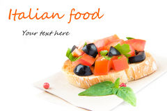 Classic Italian appetizer bruschetta with tomato, basil and blac Stock Photography
