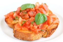 Classic italian bruschetta with tomato and basil Royalty Free Stock Photo