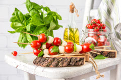 Classic Italian Caprese Canapes Salad With Tomatoes, Mozzarella And Fresh Basil stock photography