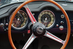 Classic italian convertible sports car interior. Classic 1958 lancia Aurelia interior gauges and steering wheel Royalty Free Stock Photos