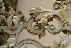 Classic Italian Ironwork. This is some Classic Ironwork from a historic building in Miami.  The Ironwork has flecks of gold from when it was compleatly coated Stock Photo