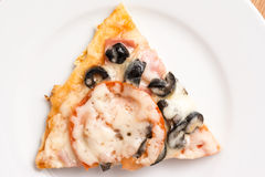 Classic Italian Pizza Slice. Served On White Plate royalty free stock photo