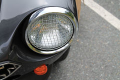 Classic italian sports car headlamp. Classic fiat 124 spider headlamp. mesh over headlamp with chrome bezel. Italian  car fiat freakout event 2012 in virginia Stock Photos