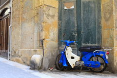 Classic Italian urban scene with scooter Stock Images