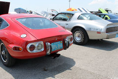 Classic japanese and american sports cars rear Stock Images