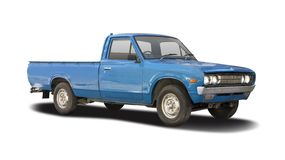 Classic Datsun pickup truck isolated on white. Classic Japanese blue pickup truck isolated on white royalty free stock photography