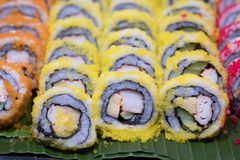 Classic Japanese food sushi set of different rolls. On banana leaf stock photos