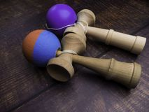Classic Japanese game kendama on wooden background. Two playing kendamas, new and used. Classic Japanese game kendama on wooden background. Two playing kendamas royalty free stock photo