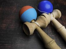 Classic Japanese game kendama on wooden background. Two playing kendamas, new and used. Classic Japanese game kendama on wooden background. Two playing kendamas stock images