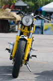 Classic Japanese motorcycle. Classic, yellow Japanese motorcycle from the early sixties royalty free stock photography