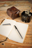 Classic journalist tools. Still life with vintage camera, fountain pen and notebook, a journalism concept Royalty Free Stock Photography