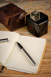 Classic journalist tools. Still life with vintage camera, fountain pen and notebook, a journalism concept Royalty Free Stock Photos