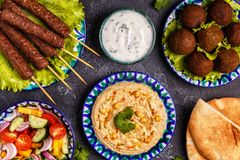 Classic kebabs, falafel and hummus on the plates. Top view Royalty Free Stock Image