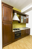 Classic kitchen. Classic, massive kitchen. Cabinets made of quality wood Royalty Free Stock Photo