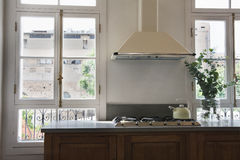 Classic kitchen with french window. Classic modern kitchen with large french windows Royalty Free Stock Photo