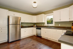 Classic kitchen with green interior paint, and white cabinets. Classic kitchen with green interior paint, hardwood floor, and white cabinets Royalty Free Stock Image