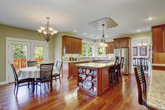 Classic kitchen with hardwood floor, china, and marble counters. Stock Photos