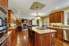 Classic kitchen with hardwood floor, china, and marble counters. Stock Image