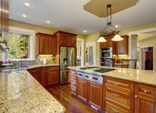 Classic kitchen with hardwood floor, china, and marble counters. Classic kitchen with marble counters and hardwood floor Stock Photography