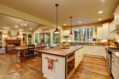 Classic kitchen with hardwood floor and an island. Classic kitchen with hardwood floor, an island, and connected dinning room Royalty Free Stock Images