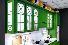 Classic kitchen interior with green trim. Kitchen acrylic countertop with built-in sink stock photo