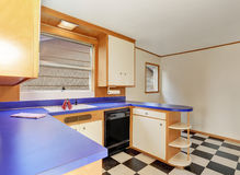 Classic kitchen room interior with white cabinets with blue counter top. Also tile floor. Northwest, USA Stock Photo