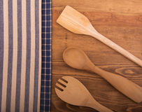 Classic kitchen towels and wooden utensils Stock Images