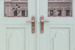 Classic knobs in door use for background Stock Photography