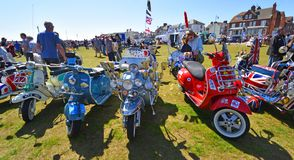 Classic Lambretta & Vespa Motor Scooters in Rally. FELIXSTOWE, SUFFOLK, ENGLAND - MAY 06, 2018: Classic Lambretta & Vespa Motor Scooters in Rally royalty free stock images