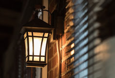 Classic lamp. On brick wall stock photography