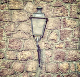 Classic lamp in a brick wall in vintage tone Stock Images